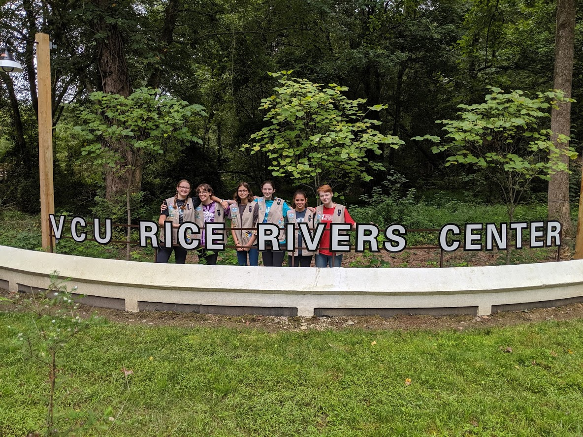 Girl Scout Troop 5184 in back of the VCU Rice Rivers sign